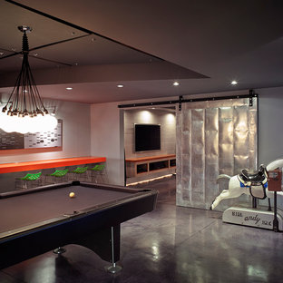 This is an example of a large contemporary basement in New York with grey floors.