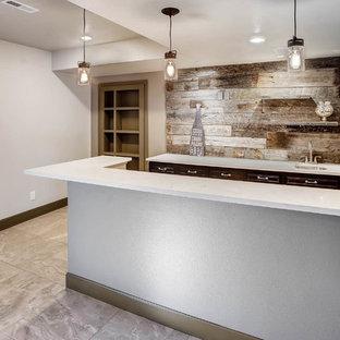 Cette photo montre un sous-sol industriel enterré et de taille moyenne avec un mur blanc, moquette, un sol gris, une cheminée standard et un manteau de cheminée en bois.