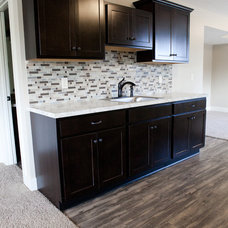 Traditional Basement by Jim Tibbe Homes