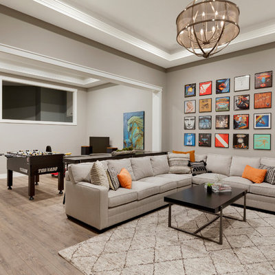 Inspiration for a large transitional underground brown floor and vinyl floor basement remodel in Minneapolis with gray walls