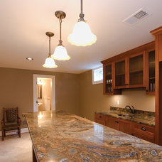 Traditional Basement by BACK Construction