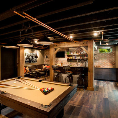 Inspiration for a large rustic look-out dark wood floor basement remodel in Seattle with beige walls