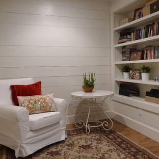 Photo of a small country look-out basement in Other with white walls, no fireplace and medium hardwood floors.
