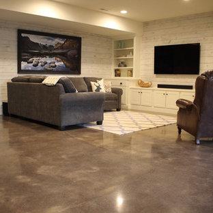 Idées déco pour un sous-sol craftsman avec béton au sol.