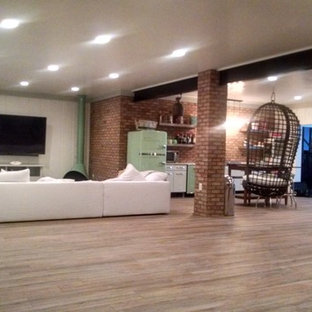 Basement - large traditional medium tone wood floor and brown floor basement idea in DC Metro with white walls and no fireplace