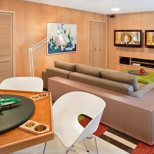 Cette image montre un grand sous-sol vintage donnant sur l'extérieur avec un mur beige et un sol en linoléum.