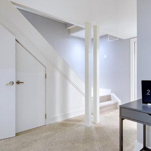 Inspiration pour un petit sous-sol design enterré avec un mur bleu, béton au sol et aucune cheminée.