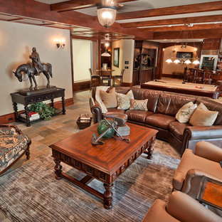 Inspiration for a large timeless look-out slate floor basement remodel in Salt Lake City with beige walls, a standard fireplace and a stone fireplace