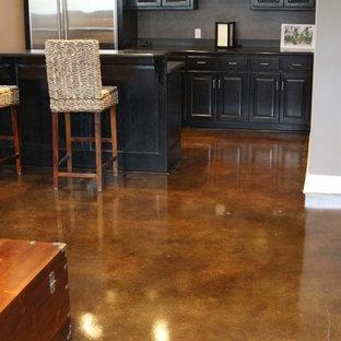 Basement - contemporary brown floor basement idea in Kansas City