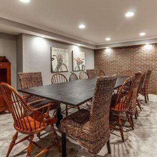 Exemple d'un grand sous-sol craftsman enterré avec un bar de salon, un mur beige, un sol en vinyl, une cheminée standard, un manteau de cheminée en bois, un sol beige et un mur en parement de brique.
