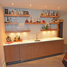 Modern Basement by Rock Point Cabinets