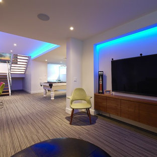 Photo of a large midcentury look-out basement in Calgary with white walls and carpet.
