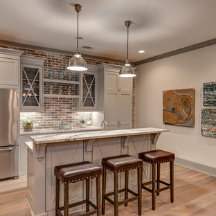 Inspiration for an expansive classic walk-out basement in Atlanta with light hardwood flooring, a brick fireplace surround and white walls.