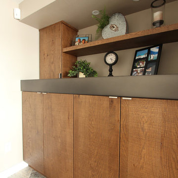 Rough Sawn Euro Oak Built In Cabinets with Custom Metal Mantle