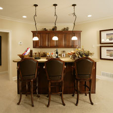 Traditional Basement by The Schnicke Company