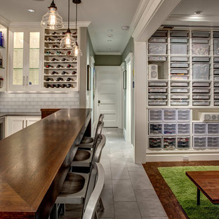 Basement - mid-sized transitional underground cork floor basement idea in Seattle with gray walls