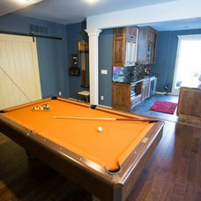 Traditional Basement by Shaping Your Space