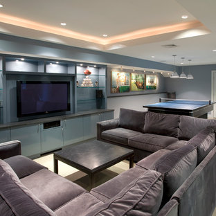 Basement - contemporary underground carpeted and beige floor basement idea in New York with blue walls and no fireplace
