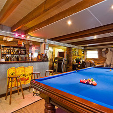 Eclectic Basement by ...talk to Di- Elders Real Estate
