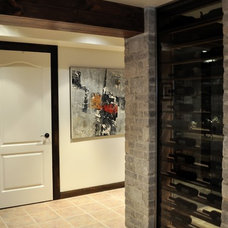 Contemporary Basement by Création Maryse Crôteau