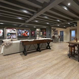 Basement - large transitional underground laminate floor basement idea in DC Metro with multicolored walls