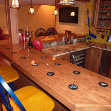 Eclectic Basement by C&A Custom Kitchens, Inc.
