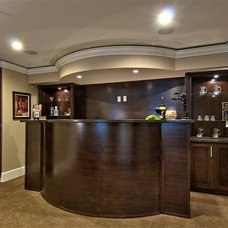 Traditional Basement by KASHMIR DHALIWAL FINE REDESIGN.