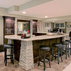 Contemporary Basement by Westlawn Construction Inc