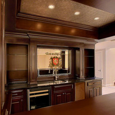 Traditional Basement by Summit Signature Homes, Inc.