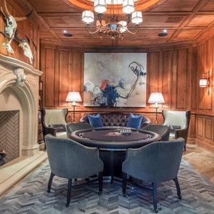 Cette image montre un sous-sol craftsman de taille moyenne avec salle de jeu, une cheminée standard, un mur marron, un sol en travertin et un manteau de cheminée en pierre.