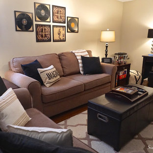 Example of a mid-sized eclectic medium tone wood floor basement design in Other with beige walls