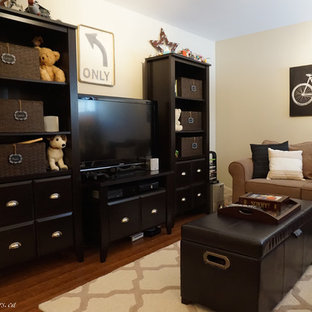 Basement - mid-sized eclectic medium tone wood floor basement idea in Other with beige walls