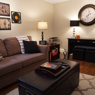 Mid-sized eclectic medium tone wood floor basement photo in Other with beige walls