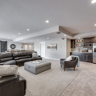 Large arts and crafts basement in Salt Lake City with grey walls and carpet.