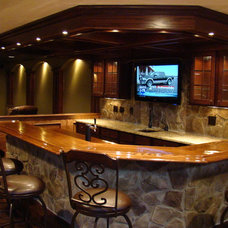 Traditional Basement by The Finished Basement
