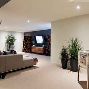 Trendy carpeted basement photo in Ottawa with gray walls
