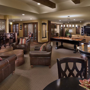 Photo of a mediterranean walk-out basement in Denver with beige walls, carpet, no fireplace and a game room.