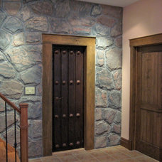 Rustic Basement by Integrity Home and Cottage