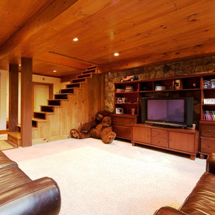 Large elegant look-out carpeted basement photo in Manchester with white walls and no fireplace