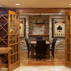 Traditional Basement by The Man Card Crew
