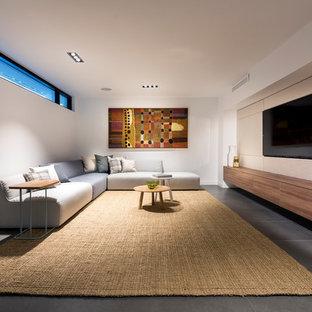 Inspiration pour un grand sous-sol minimaliste semi-enterré avec un sol en carrelage de porcelaine et un sol gris.