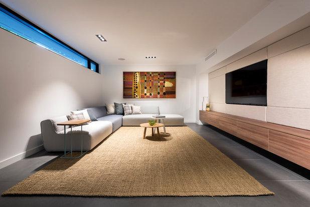 Modern Basement by Austurban Homes