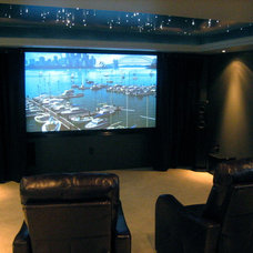 Modern Basement by Man Caves Audio Video