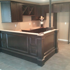 Traditional Basement by Traditions H.R.C. Inc.