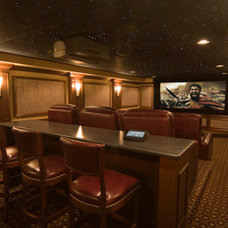 Traditional Basement by Man Caves Audio Video
