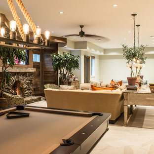 Basement - large rustic look-out carpeted and beige floor basement idea in St Louis with beige walls, a standard fireplace and a stone fireplace
