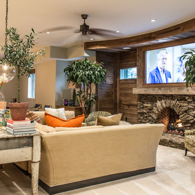 Large mountain style look-out carpeted and beige floor basement photo in St Louis with beige walls, a standard fireplace and a stone fireplace