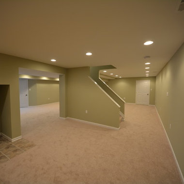 finished basement with wet bar and family room and kids play area