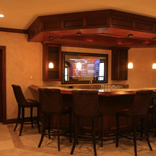 Traditional Basement by Berriz Design Build Group