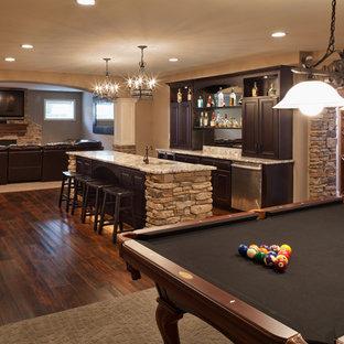 Example of a classic brown floor basement design in Cincinnati